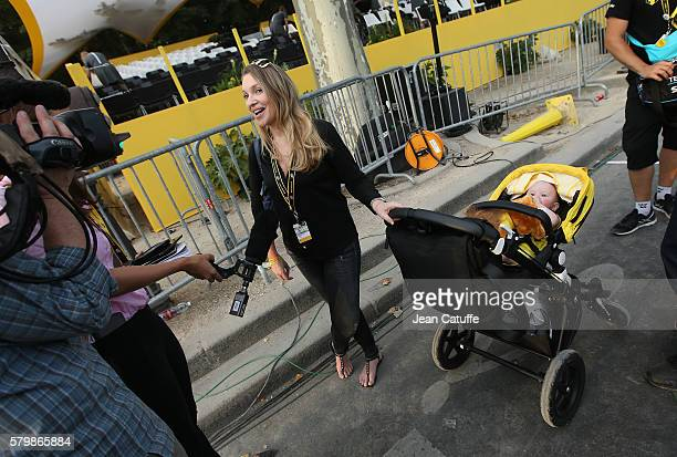 Michelle Froome wife of Chris Froome of Great Britain and Team Sky answers to an interview while their son Kellan Froome lies on his yellow stroller...
