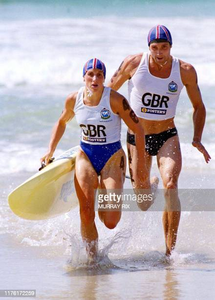 Michelle Gammon and Nick Thorn of Great Britain exit the surf to finish second in the Mixed Board Rescue competition at Kurrawa Beach at Queensland's...