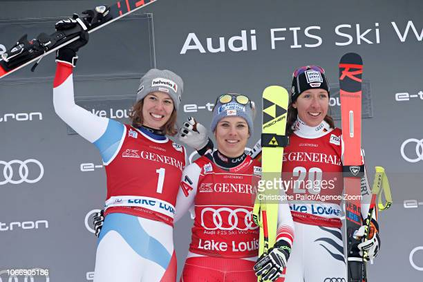Michelle Gisin of Switzerland takes 2nd place Nicole Schmidhofer of Austria takes 1st place Kira Weidle of Germany takes 3rd place during the Audi...