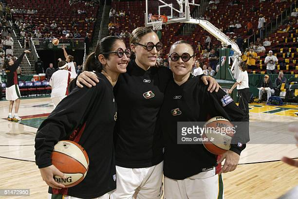 Michelle Greco Adia Barnes and Tully Bevilaqua of the Seattle Storm pose before game three of the WNBA Finals against the Connecticut Sun on October...
