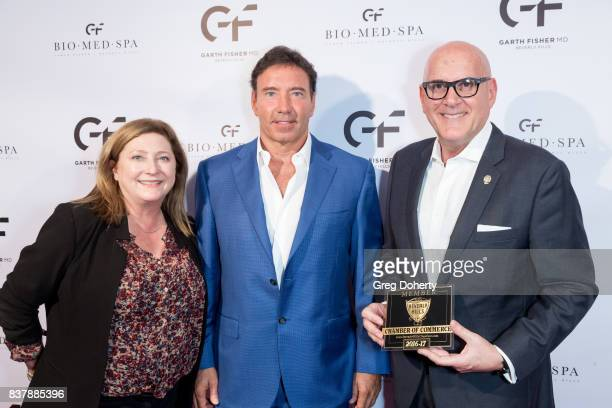 Michelle Green with the Beverly Hills Chamber of Commerce Dr Garth Fisher MD and Jeffrey Evans with the Beverly Hills Chamber of Commerceattend the...