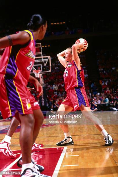 Michelle Griffiths of the Phoenix Mercury passes the ball against during Game Three of the 1998 WNBA Finals on September 1 1998 at the Compaq Center...