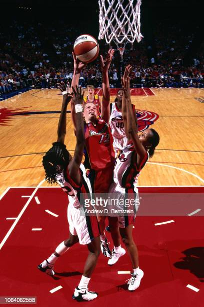 Michelle Griffiths of the Phoenix Mercury shoots during Game Three of the 1998 WNBA Finals on September 1 1998 at the Compaq Center in Houston Texas...