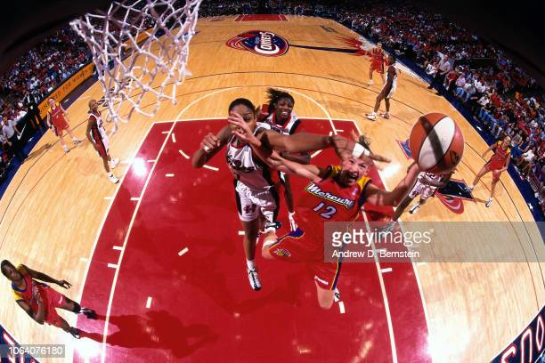 Michelle Griffiths of the Phoenix Mercury shoots during Game Two of the 1998 WNBA Finals on August 29 1998 at the Compaq Center in Houston Texas NOTE...