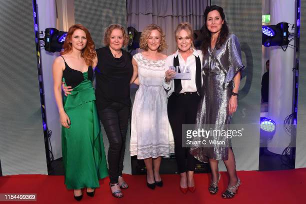 Michelle Hardwick with Victoria Broom and Nicola Stephenson with the award for 'Actor of the year' at the Diva Awards 2019 at The Waldorf Hilton...