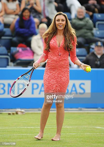 Michelle Heaton hits tennis balls into the crowd on Ann Jones centre court during Ladies' Day on day five of the AEGON Classic tennis tournament at...