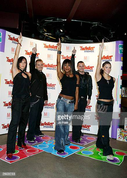 Michelle Heaton Kevin Simm Kelli Young Tony Lundon and Jessica Taylor of Liberty X promote the new game 'Twister Moves' during the launch at the CC...