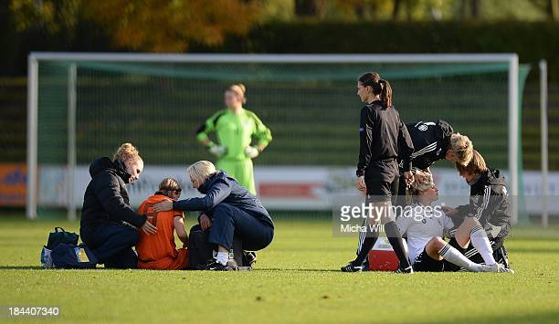Michelle Hendriks of Netherlands and Saskia Matheis of Germany are treated by the doctors after clashing during the U17 Girls Euro Qualifier match...