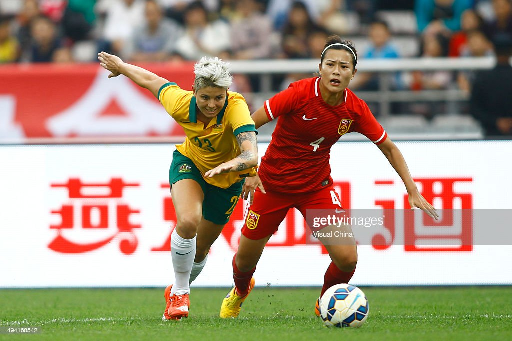 Michelle Heyman #23 of Australia and Li Jiayue #4 of China compete for the ball in the match between China and Australia during the 2015 Yongchuan Women's Football International Matches at Yongchuan Sports Center on October 25, 2015 in Yongchuan, Chongqing of China.
