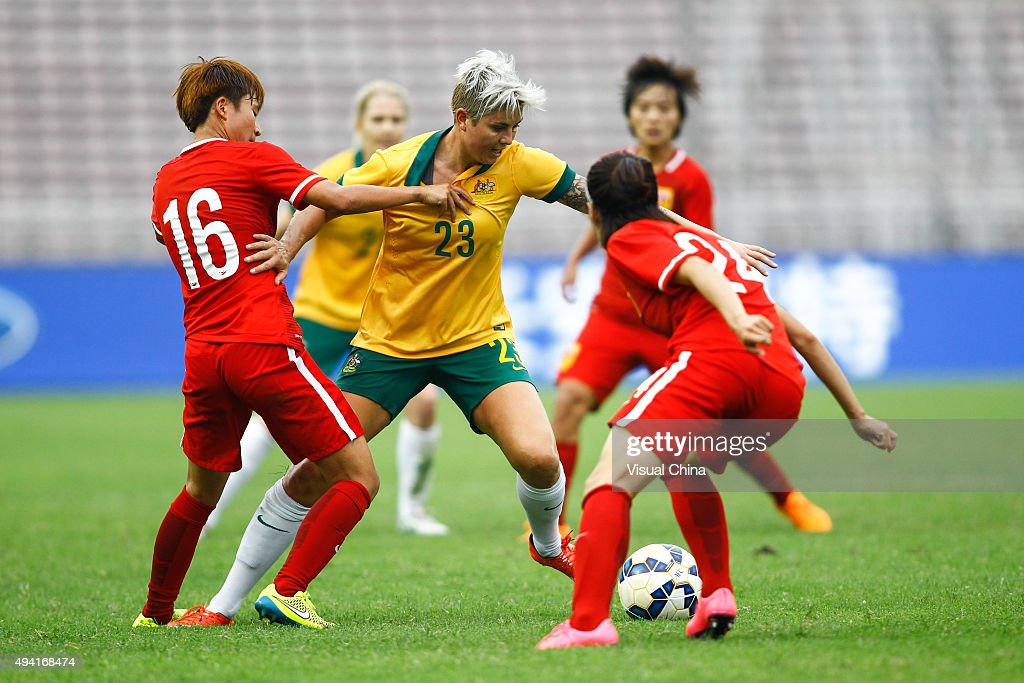 Michelle Heyman #23 of Australia and Lou Jiahui #16 of China compete for the ball in the match between China and Australia during the 2015 Yongchuan Women's Football International Matches at Yongchuan Sports Center on October 25, 2015 in Yongchuan, Chongqing of China.