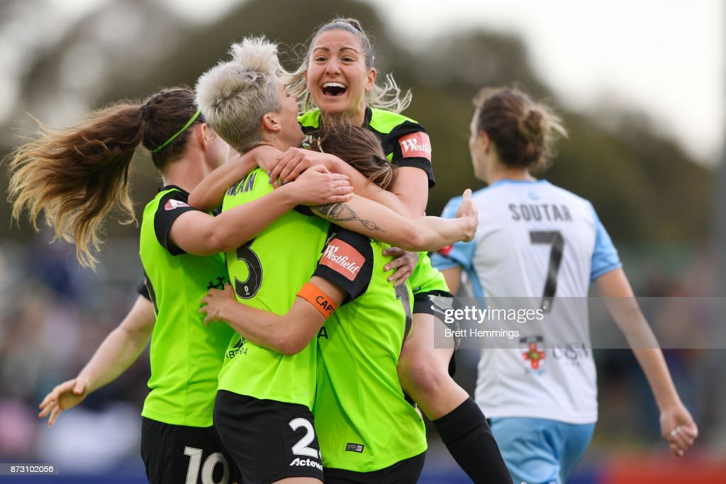 Michelle Heyman of Canberra celebrates scoring a goal with team mates during the round three W-League match between Canberra United and Sydney FC at McKellar Park on November 12, 2017 in Canberra, Australia.