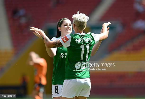 Michelle Heyman of Canberra celebrates with Meg McLaughlin after scoring a goal during the round one WLeague match between the Brisbane Roar and...