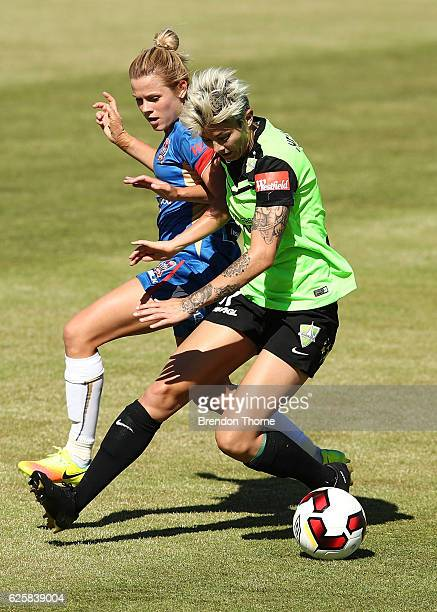 Michelle Heyman of Canberra competes with Cassidy Davis of the Jets during the round four WLeague match between Canberra United and the Newcastle...