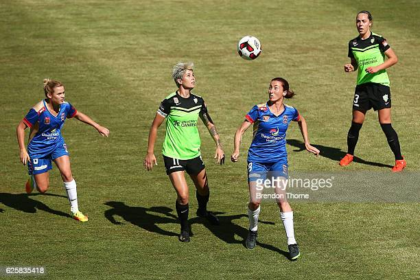 Michelle Heyman of Canberra competes with Emma Stanbury of the Jets during the round four WLeague match between Canberra United and the Newcastle...