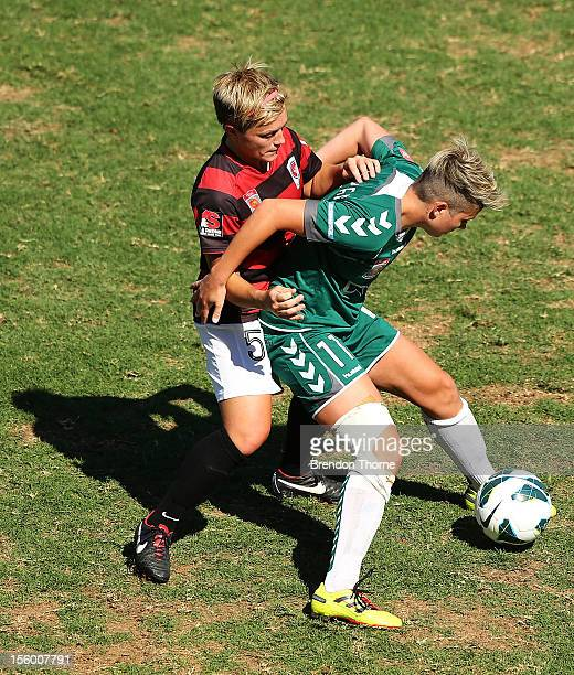 Michelle Heyman of Canberra competes with Olivia Kennedy of the Wanderers during the round four WLeague match between the Western Sydney Wanderers...