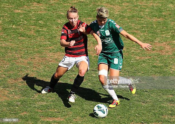 Michelle Heyman of Canberra competes with Teigen Allen of the Wanderers during the round four WLeague match between the Western Sydney Wanderers and...