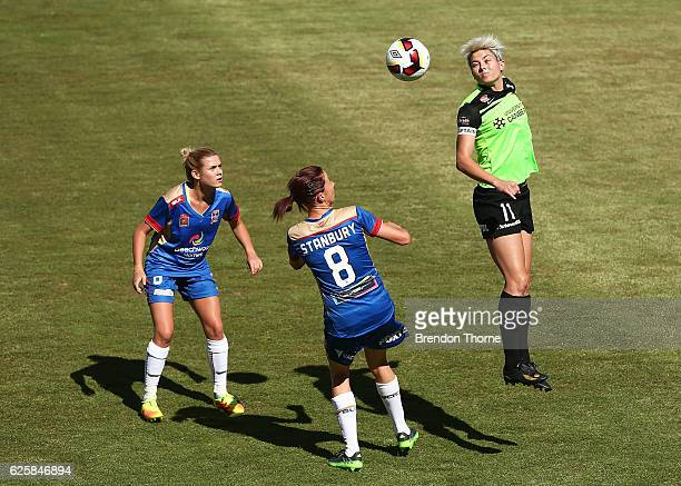 Michelle Heyman of Canberra heads the ball during the round four WLeague match between Canberra United and the Newcastle Jets at McKellar Park on...