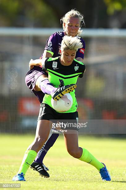 Michelle Heyman of Canberra is challenged for the ball by Kim Carroll of the Glory during the round 12 WLeague match between Perth Glory and Canberra...