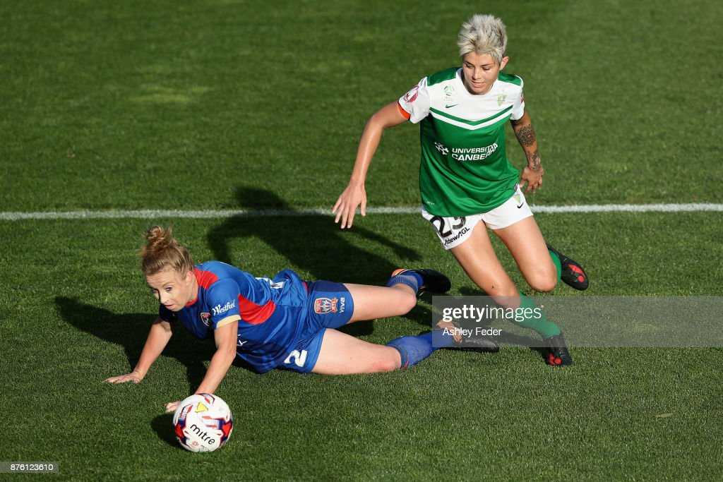 Michelle Heyman of Canberra United contests the ball against Hannah Brewer of the Jets during the round four W-League match between Newcastle and Canberra on November 19, 2017 in Newcastle, Australia.