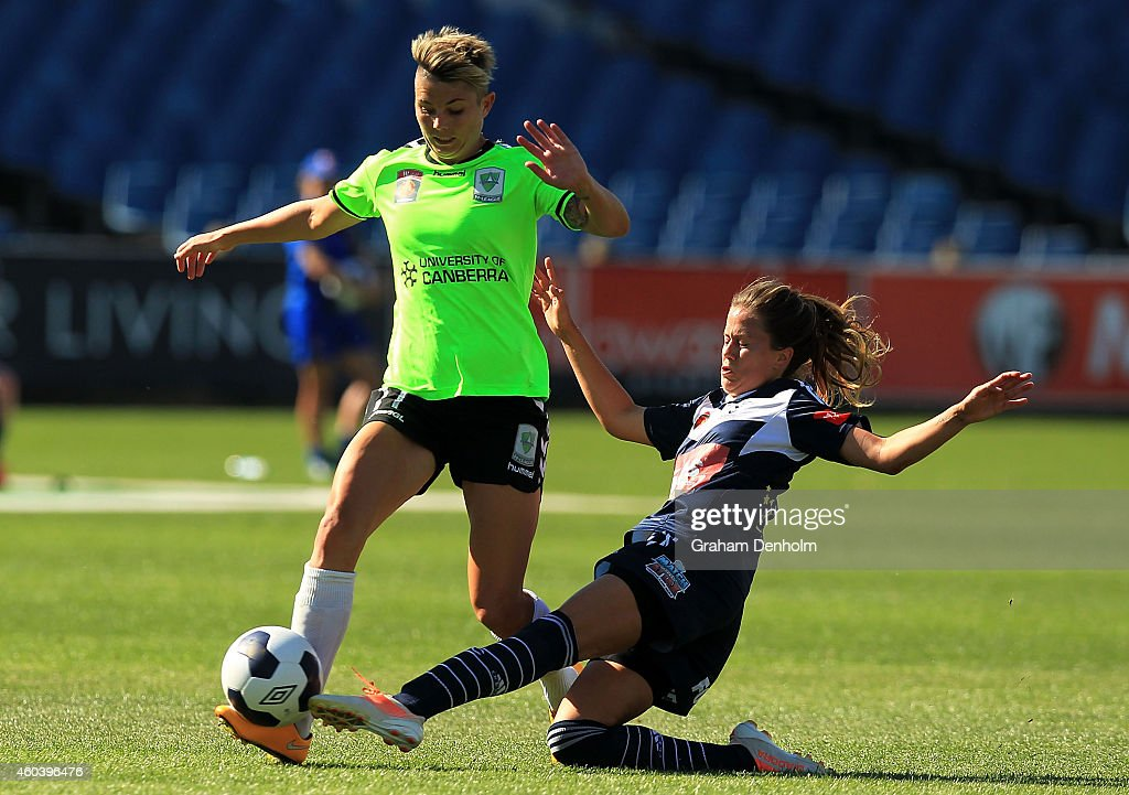 Michelle Heyman of United (L) is tackled by Lauren Barnes of the Victory during the W-League Semi Final match between Melbourne Victory and Canberra United at Simonds Stadium on December 13, 2014 in Geelong, Australia.