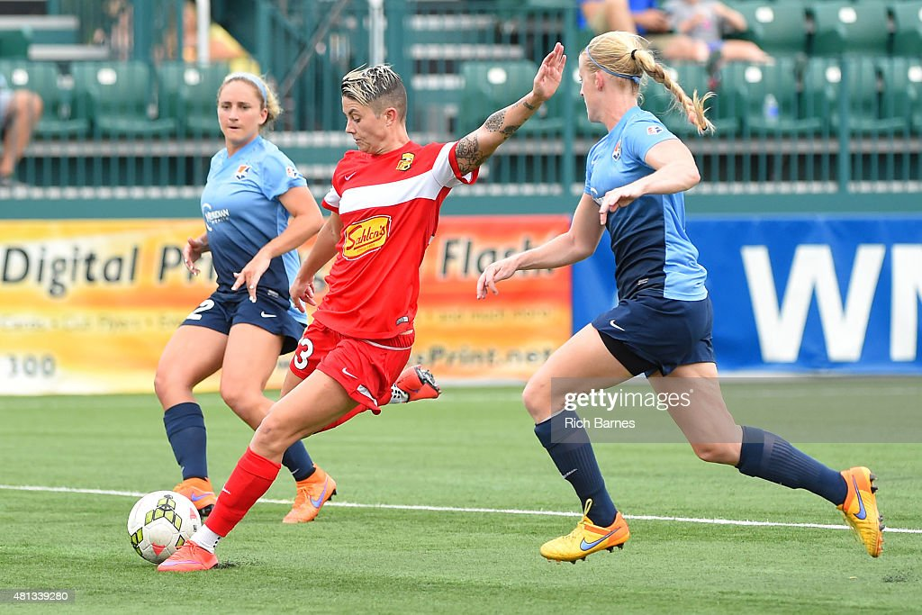 Michelle Heyman #23 of Western New York Flash takes a shot between Cami Levin #22 and Hayley Haagsma #17 of Sky Blue FC during the second half at Sahlen's Stadium on July 19, 2015 in Rochester, New York.