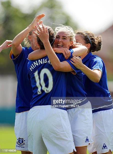 Michelle Hinnigan of Everton celebrates with team-mates after scoring her side's second goal during the FA WSL match between Everton Ladies FC and...