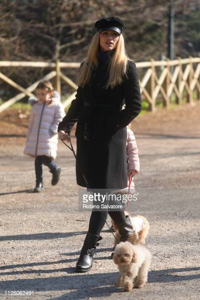 Michelle Hunziker is seen with her daughters Sole Trussardi and Celeste Trussardi in the park on February 15 2019 in Milan Italy