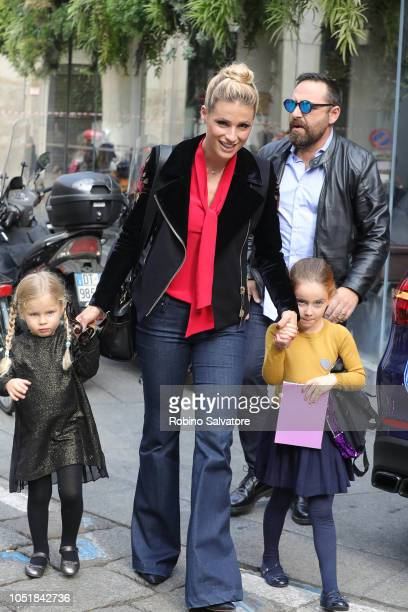 Michelle Hunziker is seen with her daughters Sole Trussardi and Celeste Trussardi on October 10 2018 in Milan Italy