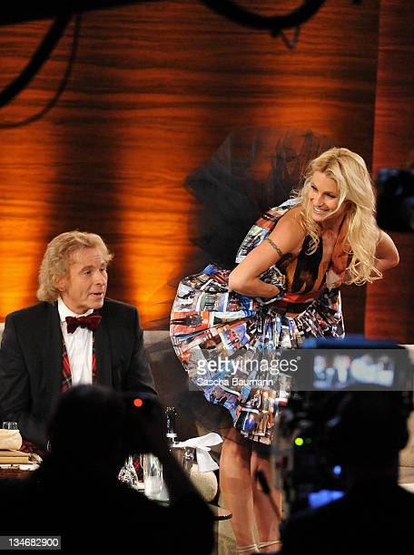 Michelle Hunziker presents a surprise dress to Thomas Gottschalk make out of pictures from his outfits during the 199th 'Wetten dass' show at the...