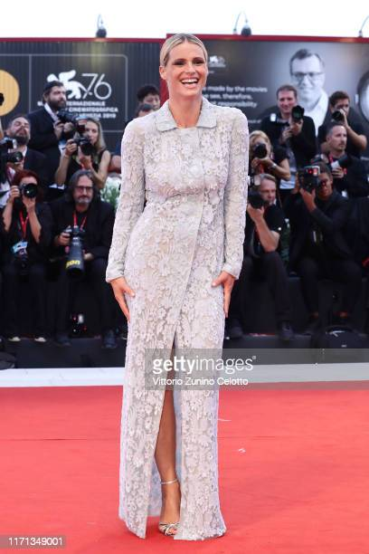 Michelle Hunziker walks the red carpet ahead of the Joker screening during the 76th Venice Film Festival at Sala Grande on August 31 2019 in Venice...