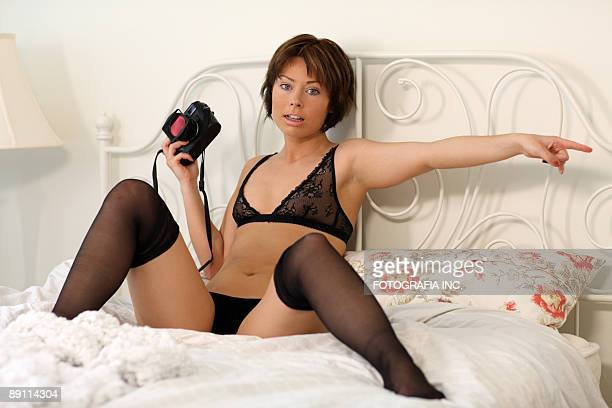 michelle in bedroom 2 - legs apart stock pictures, royalty-free photos & images
