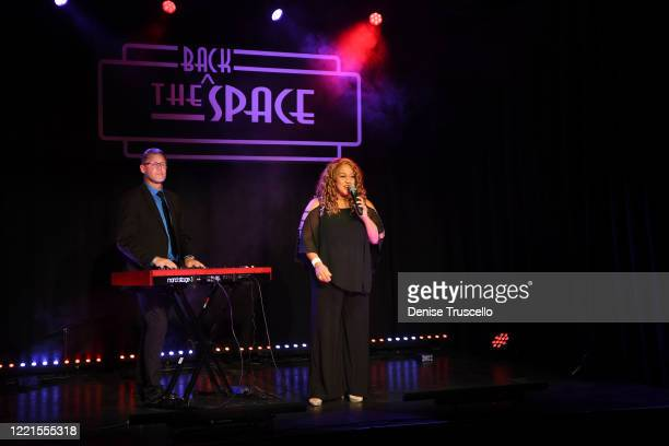 Michelle Johnson performs at the Mondays Dark Live Stream Telethon for the Actors Fund of Las Vegas at The Space on April 27 2020 in Las Vegas Nevada...