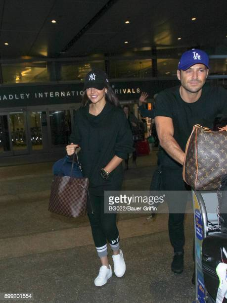 Michelle Keegan and Mark Wright are seen at Los Angeles International Airport on December 27 2017 in Los Angeles California