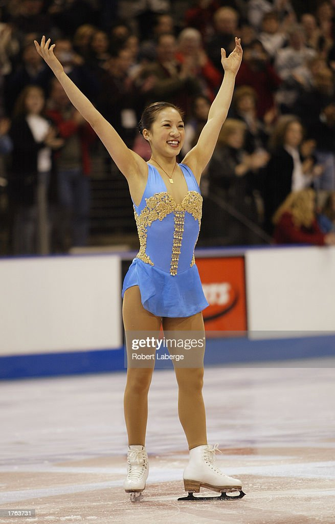 Michelle Kwan acknowledges the crowd after winning gold in the State Farm US Figure Skating Championships on January 18, 2003 at the American Airlines Center in Dallas, Texas.