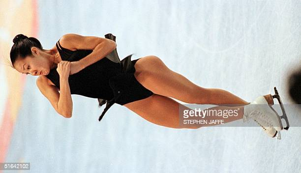 Michelle Kwan from California does a triple axel during a practice session 10 January at the US Figure Skating Championships at CoreStates Center in...