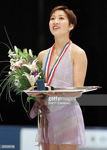 Michelle Kwan from Los Angeles California celebrates her first place win in the Championship Ladies Free Program 13 February in the State Farm US...
