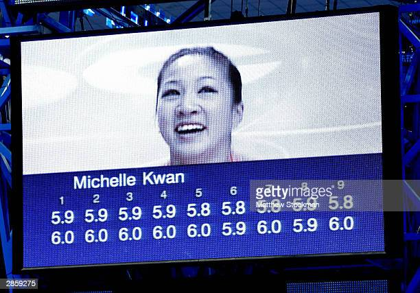Michelle Kwan likeness on screen as scores are displayed after the free skate during the State Farm US Figure Skating Championships January 10 2004...