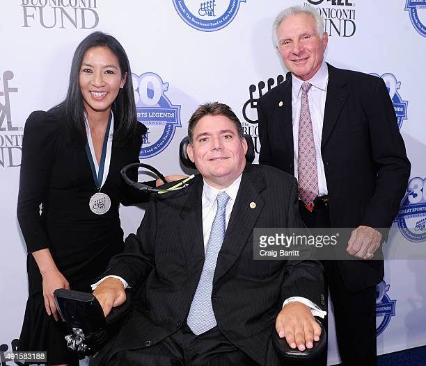 Michelle Kwan Marc Buoniconti and Nick Buoniconti attend the 30th Annual Great Sports Legends Dinner to benefit The Buoniconti Fund to Cure Paralysis...