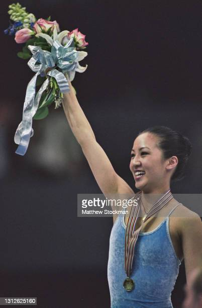 Michelle Kwan of the United States celebrates winning the gold medal in the Ladies Figure Skating Singles competition during the ISU World Figure...