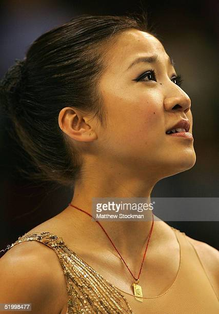 Michelle Kwan waits on the winner's podium after winning first place for the ninth straight year in the women's competition during the State Farm US...