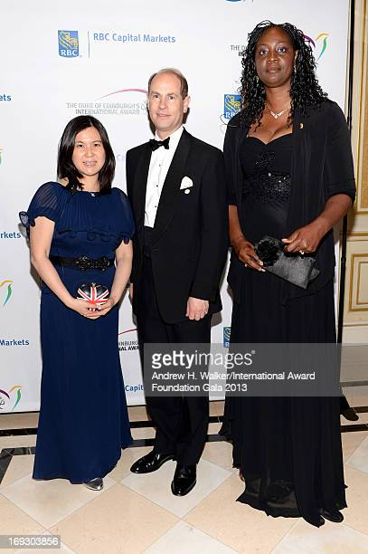 Michelle Kwong HRH Prince Edward Earl of Wessex and Jennifer ViechwegHorsford pose on the red carpet at The Duke Of Edinburgh's International Award...