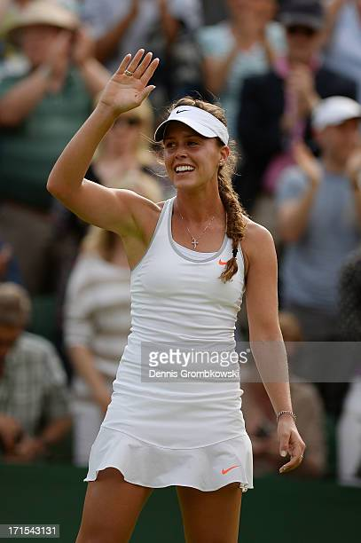 Michelle Larcher de Brito of Portugal celebrates match point during her Ladies' Singles second round match against Maria Sharapova of Russia on day...