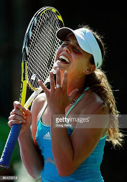 Michelle Larcher De Brito of Portugal reacts after scoring a point against Agnieszka Radwanska of Poland during day five of the Sony Ericsson Open at...
