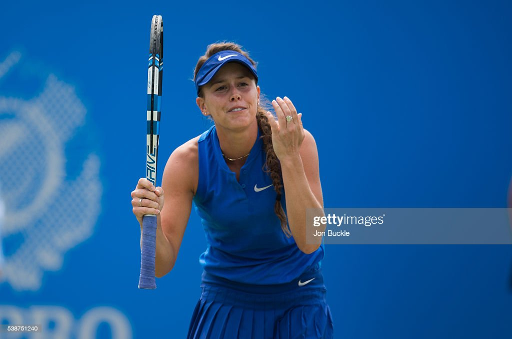 Michelle Larcher De Brito of Portugal stands dejected during her women's singles match against Monica Puig of Peru on day three of the WTA Aegon Open on June 8, 2016 in Nottingham, England.
