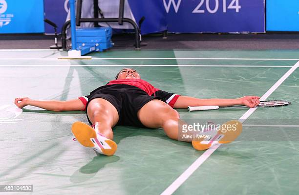 Michelle Li of Canada celebrates victory in the Women's Singles Gold Medal Match against Kirsty Gilmour of Scotland at Emirates Arena during day...