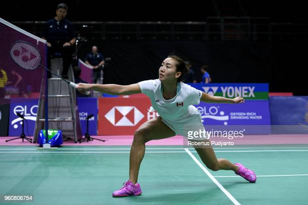 Michelle Li of Canada competes against Nozomi Okuhara of Japan during Preliminary Round on day two of the BWF Thomas Uber Cup at Impact Arena on May...