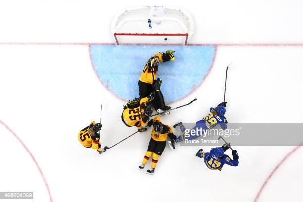 Michelle Lowenhielm of Sweden scores the third goal against Germany in the third period during the Women's Ice Hockey Preliminary Round Group B game...
