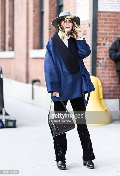 Michelle Madsen is seen outside the Creatures of Comfort show wearing a blue and black wool coat black pants with a grey hat during New York Fashion...