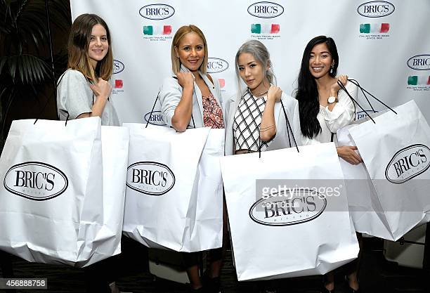 Michelle Madsen Taye Hansberry Eugenie and Stephine Liu attend Tracy Paul Company presenting BRIC'S Luggage at The Four Seasons on October 8 2014 in...