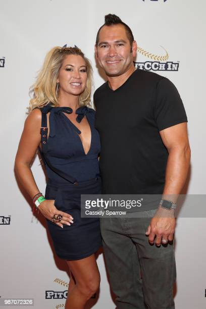 Michelle Mangan and Johnny Damon attend CC Sabathia's PitCChIn Foundation Celebrity Softball Game at Yankee Stadium on June 28 2018 in New York City